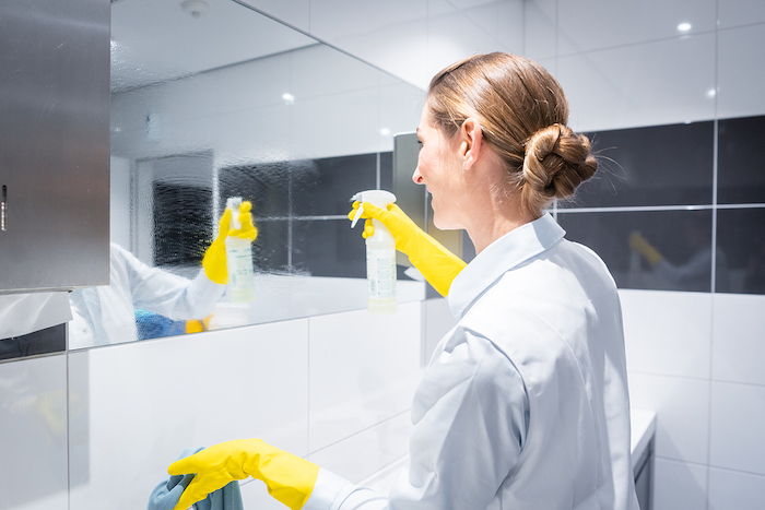 woman cleaning a bathroom